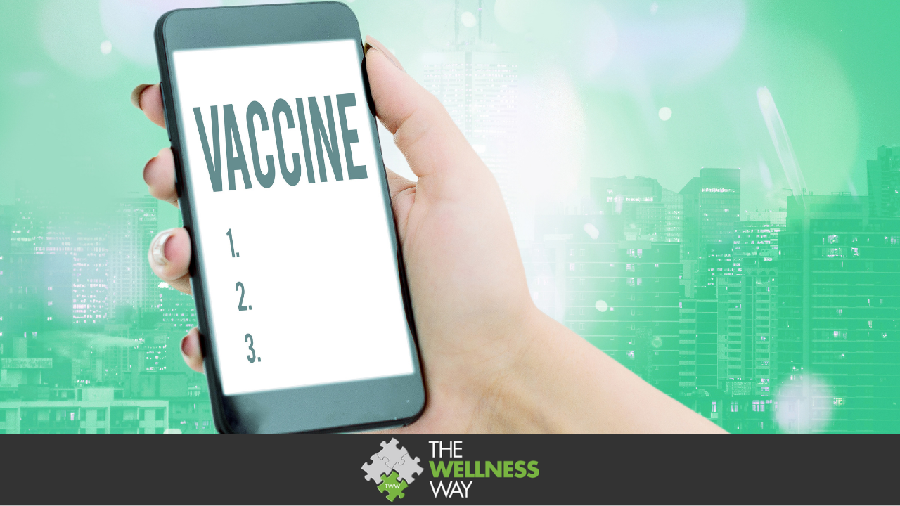 """A woman's hand is holding a phone. On the screen is the word """"vaccine"""" and the numbers 1, 2, 3 in a list form. This is set against a green background."""