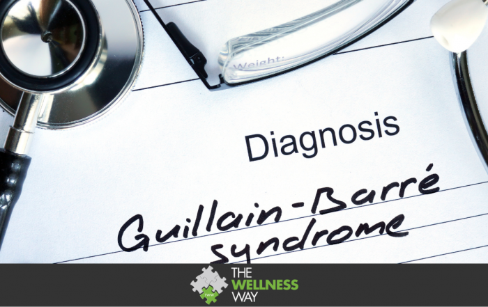 a diagnosis pad with the words Guillain-Barre Syndrome written in black ink. A stethoscope and pair of glasses are laid on the edges of the pad.