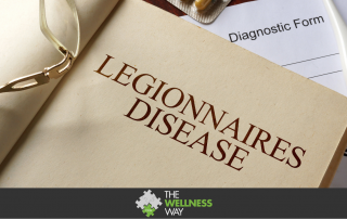 An open book with Legionnaires Disease written on the page is open, lying on a diagnostic pad