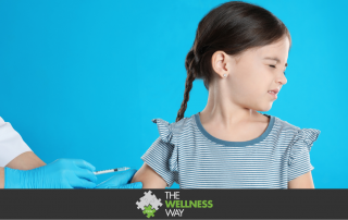 Doctor vaccinating little child on light blue background