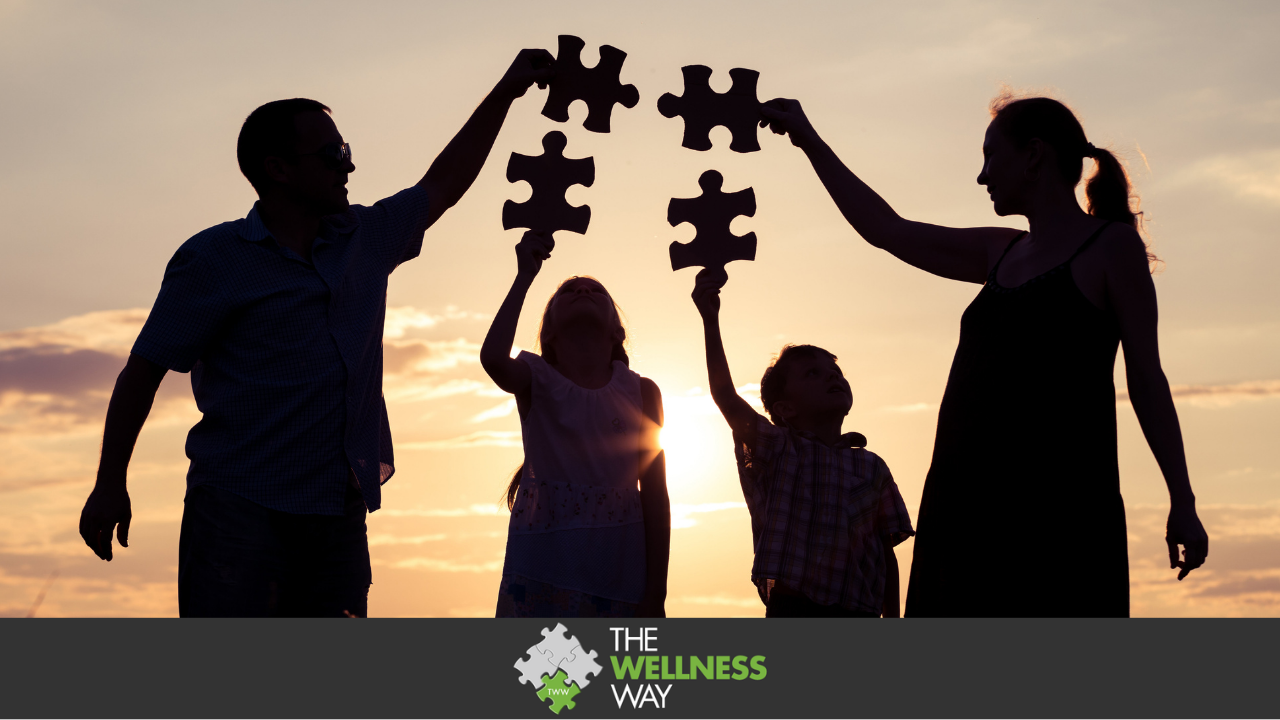 A silohuette image of a family at sunset. Each person is holding up a puzzle piece