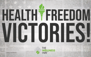 The words Health Freedom Victories over a background of a newspaper page