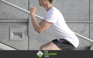 young man doing squat exercises on a step